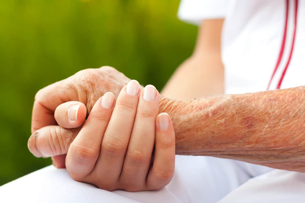 senior elderly man holding hands aging iq news