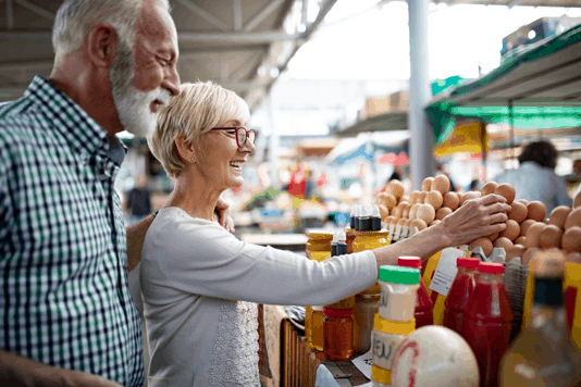 man and woman shopping for groceries smiling