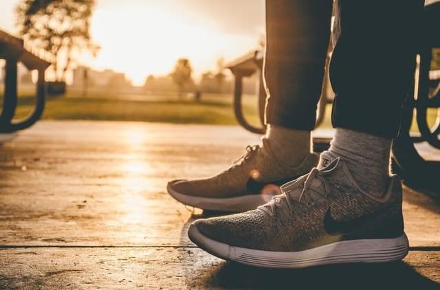 sneakers trainers walking on sidewalk