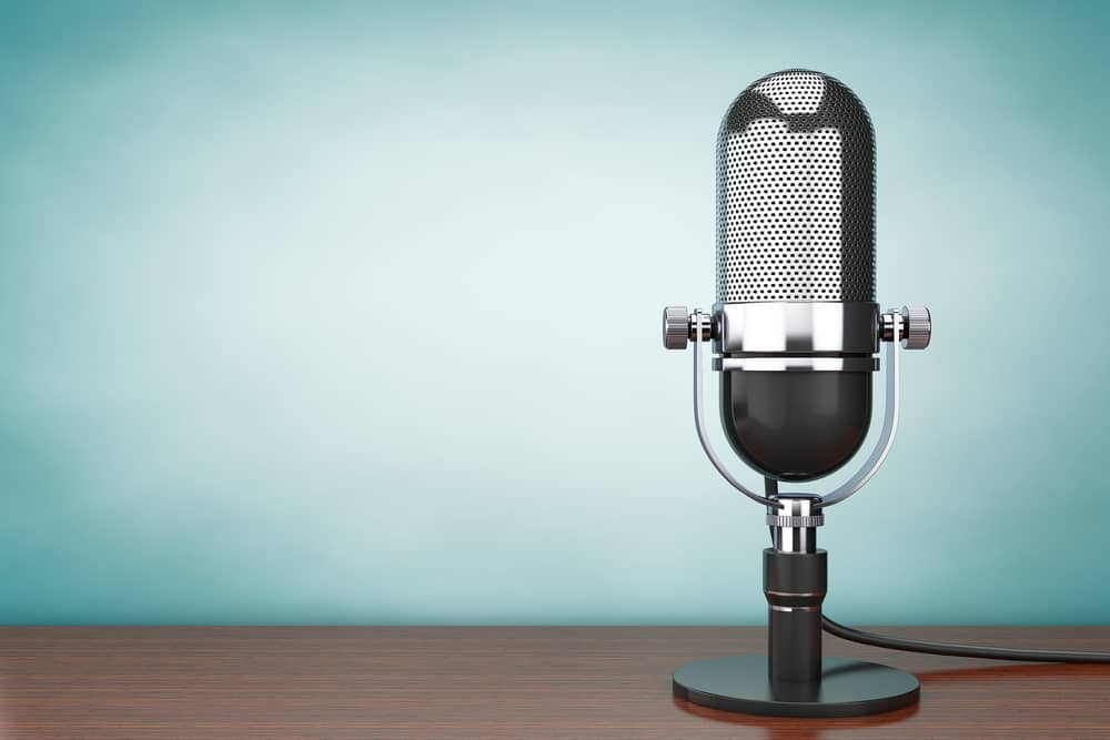 podcast microphone blue background