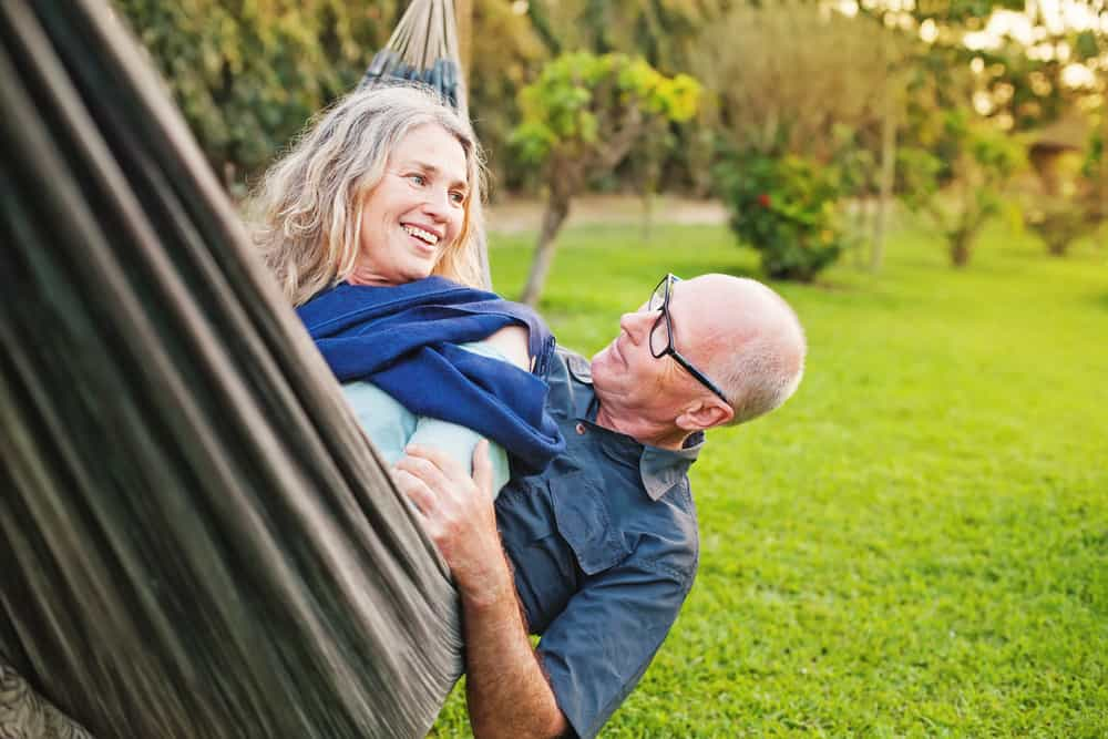 smiling couple on hammock in nature