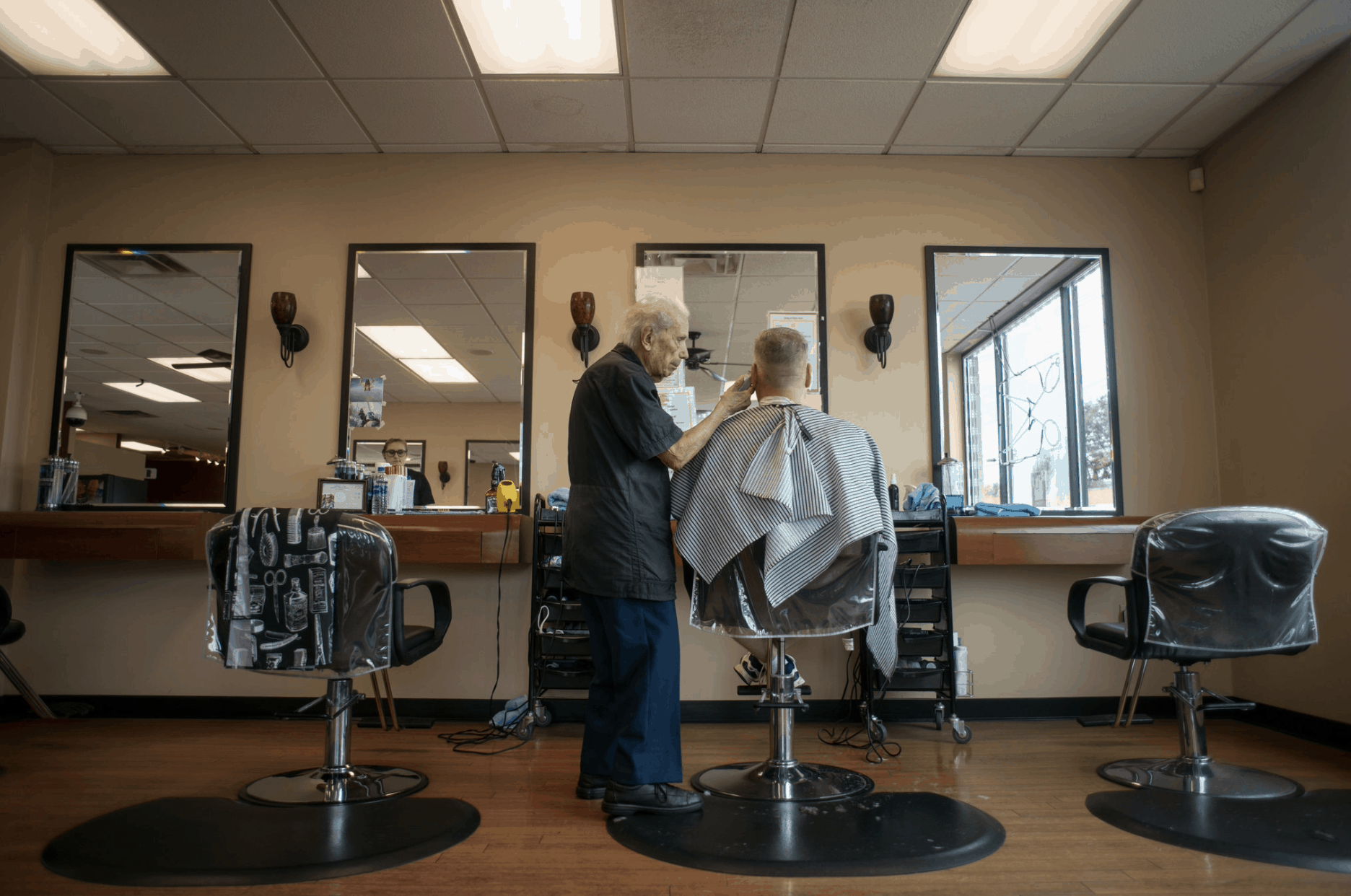Anthony Mancinelli Barber Cutting Hair