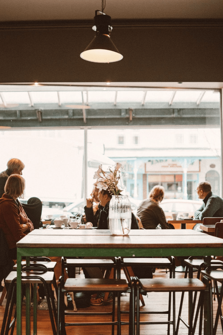 People talking at table in cafe