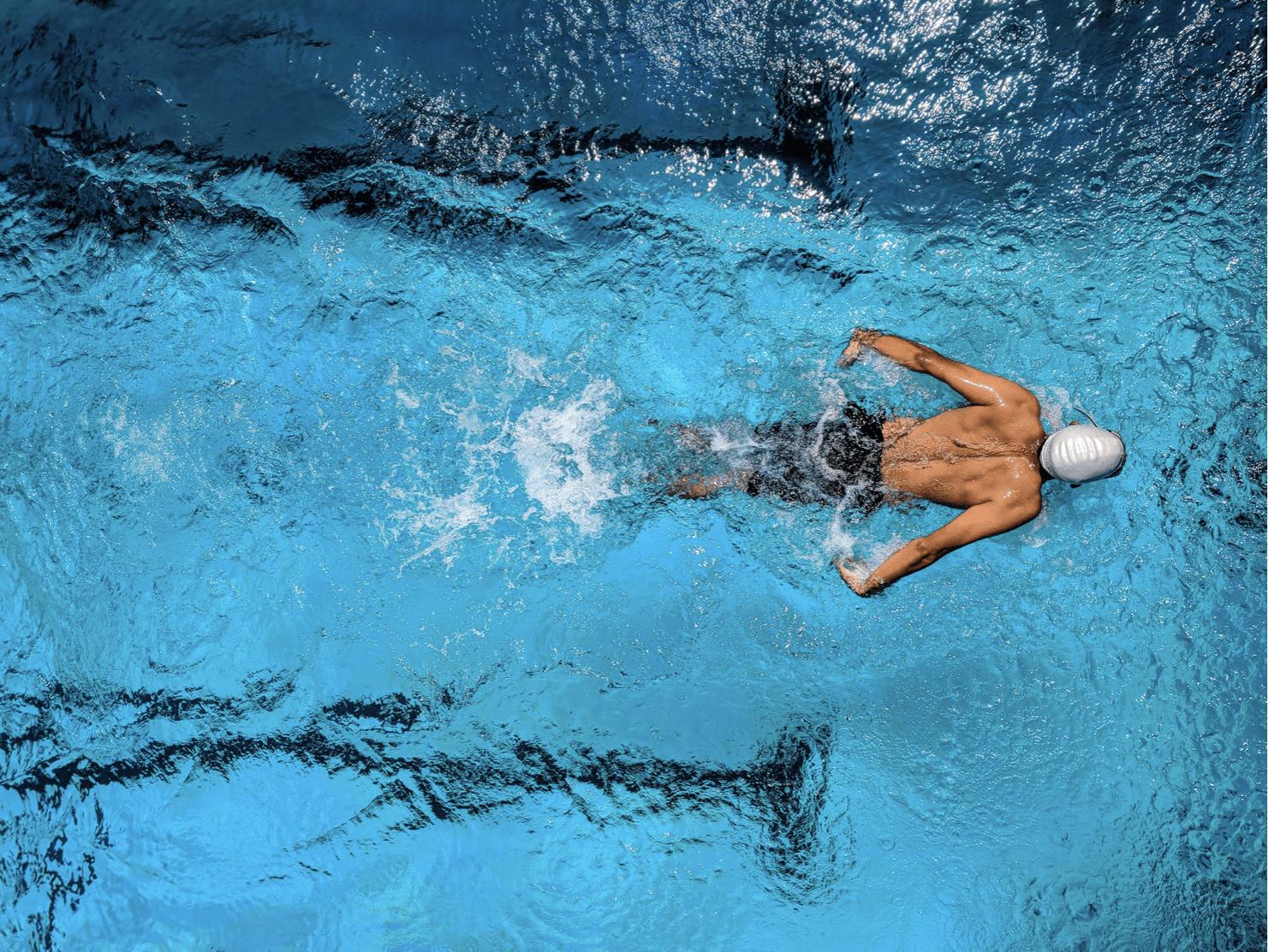 Man Swimming in pool lane