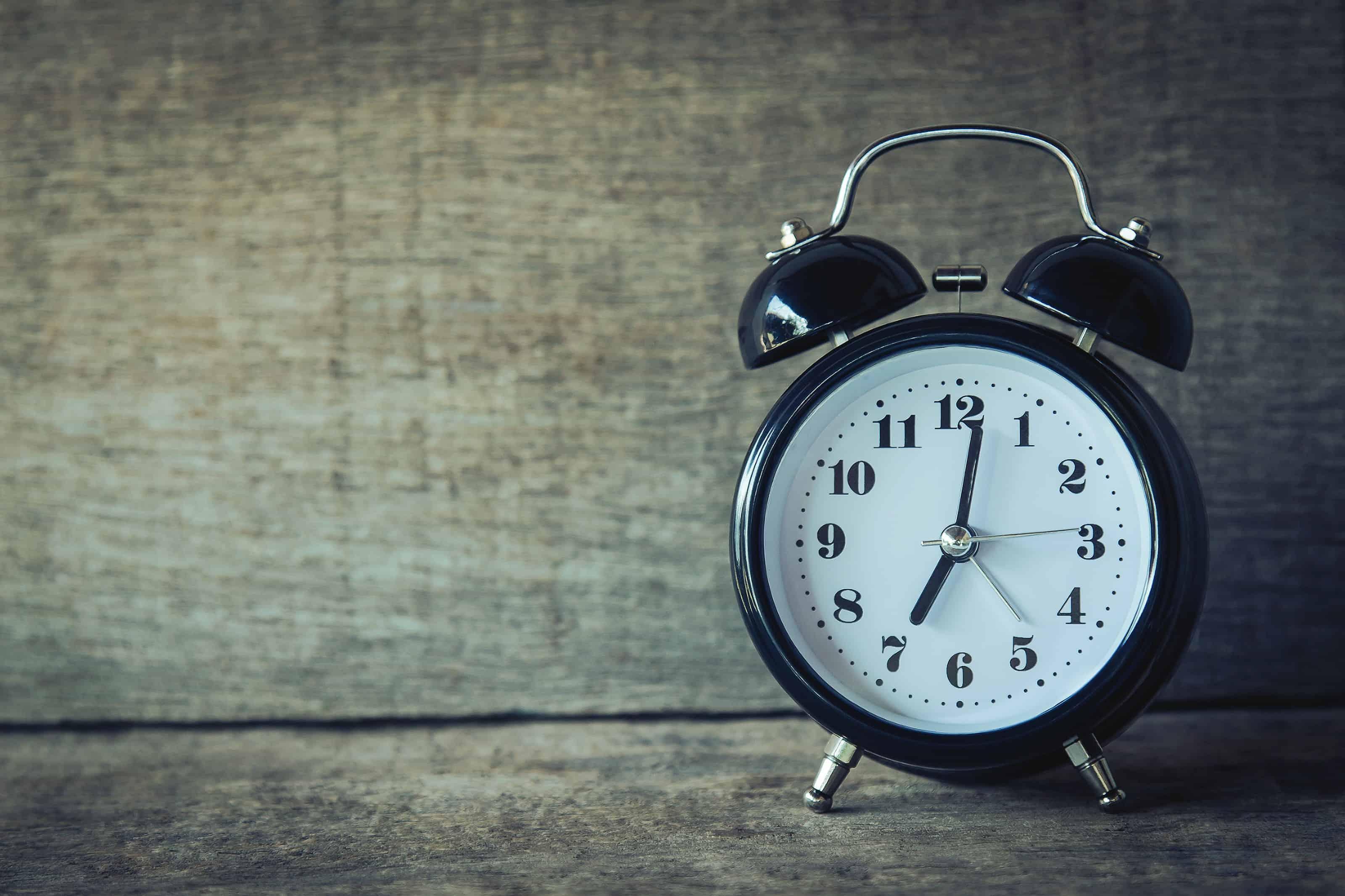 alarm clock on gray background