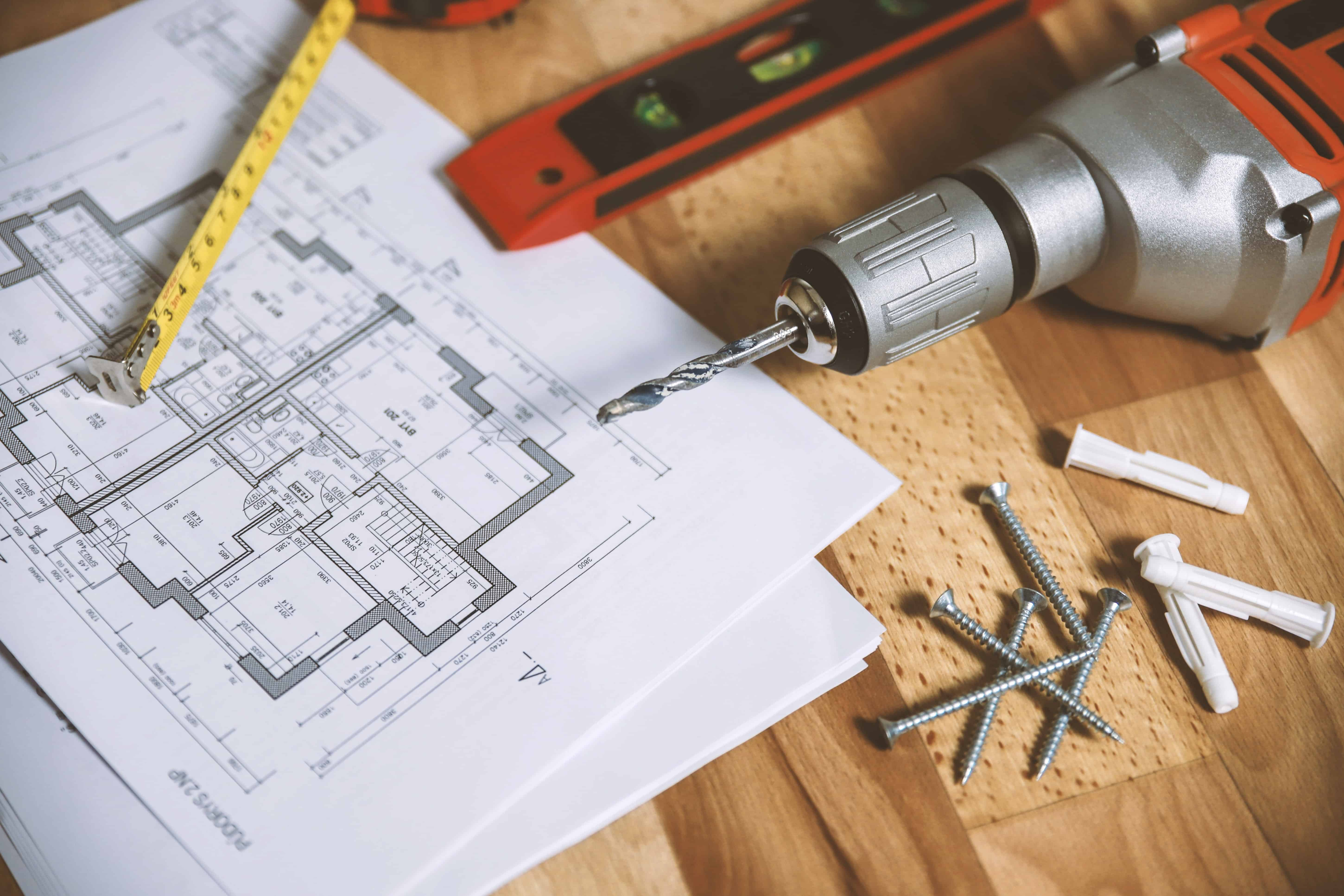 architectural Floor plan on table with drill and nails