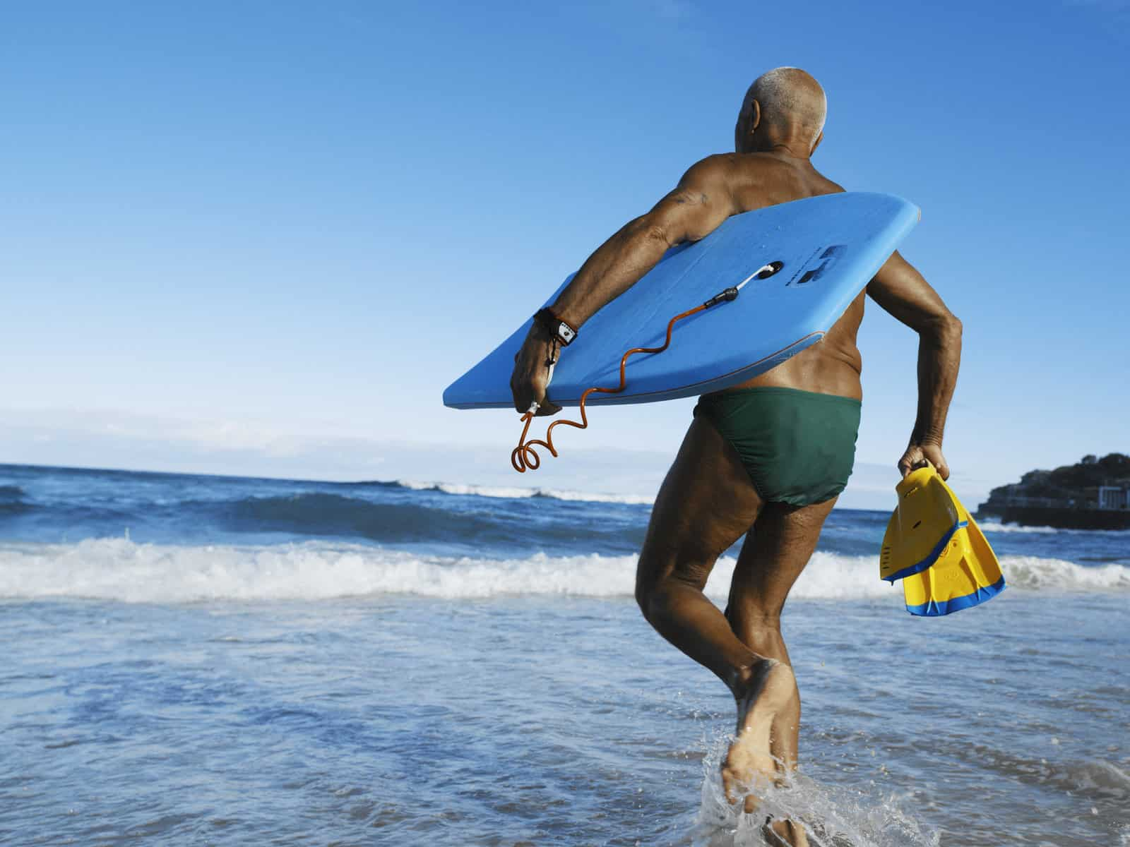 Senior Exercise old man surfing beach