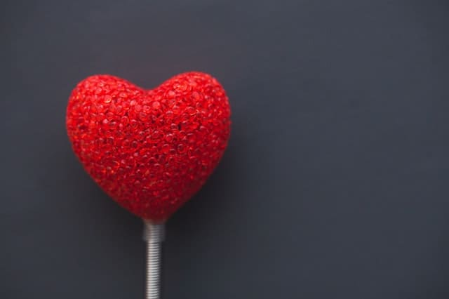 red heart on a stick