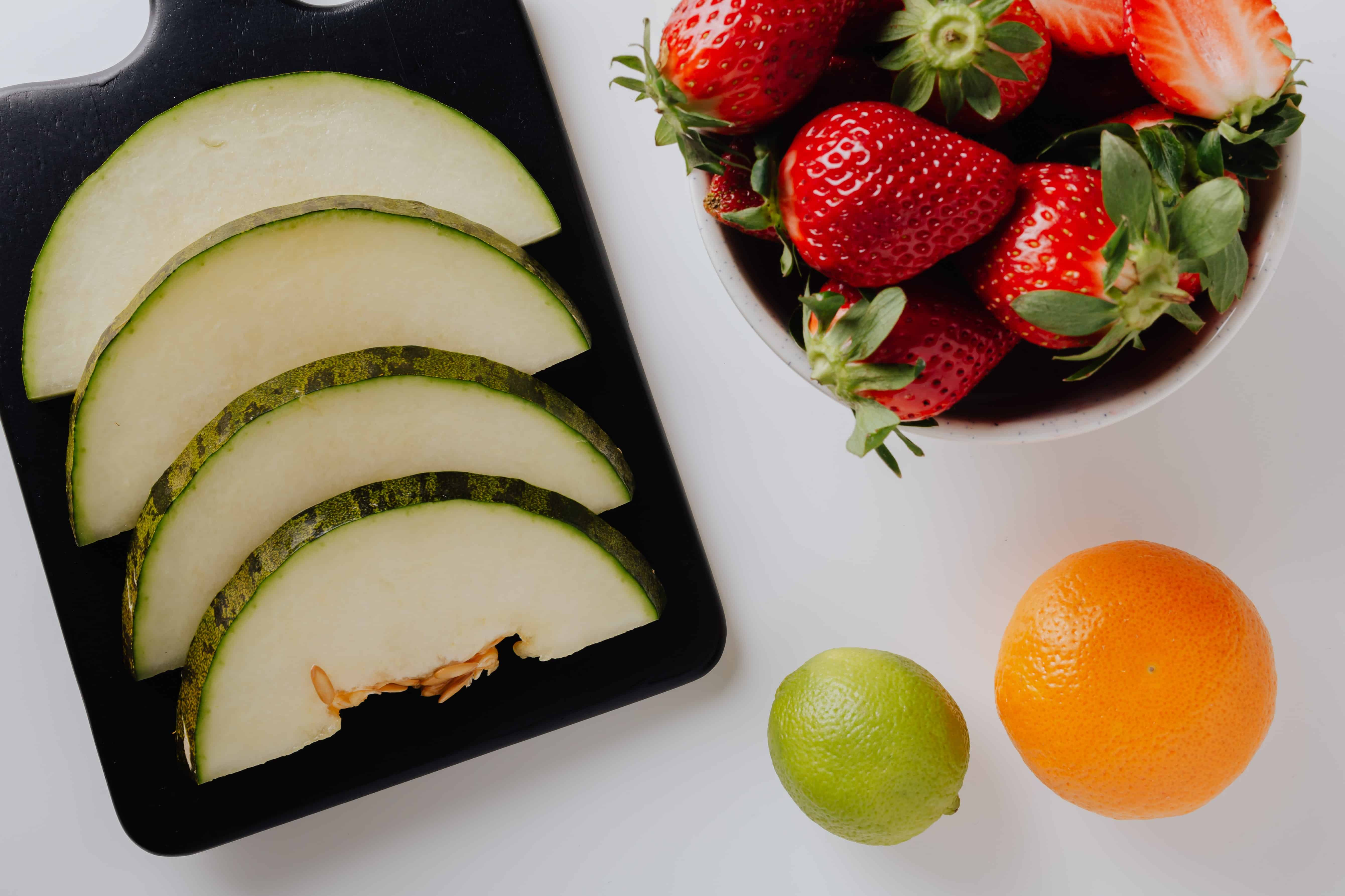 Arranged Fruit strawberry orange melon and lime