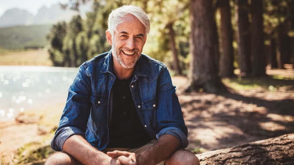 Man smiling outdoors denim jacket