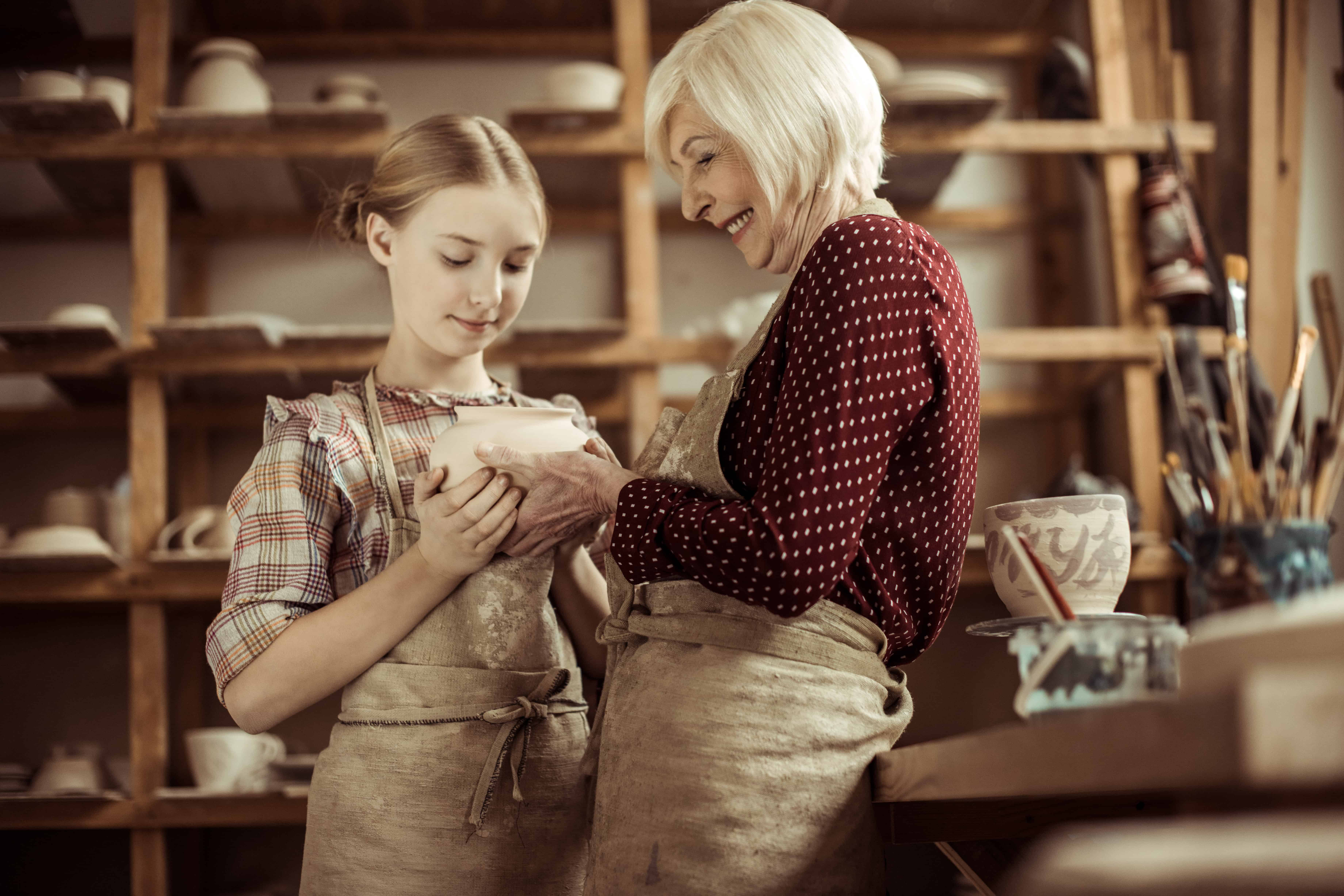 old and young woman make pottery