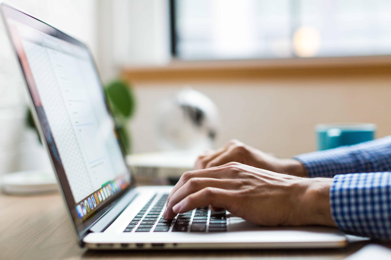 person using macbook computer