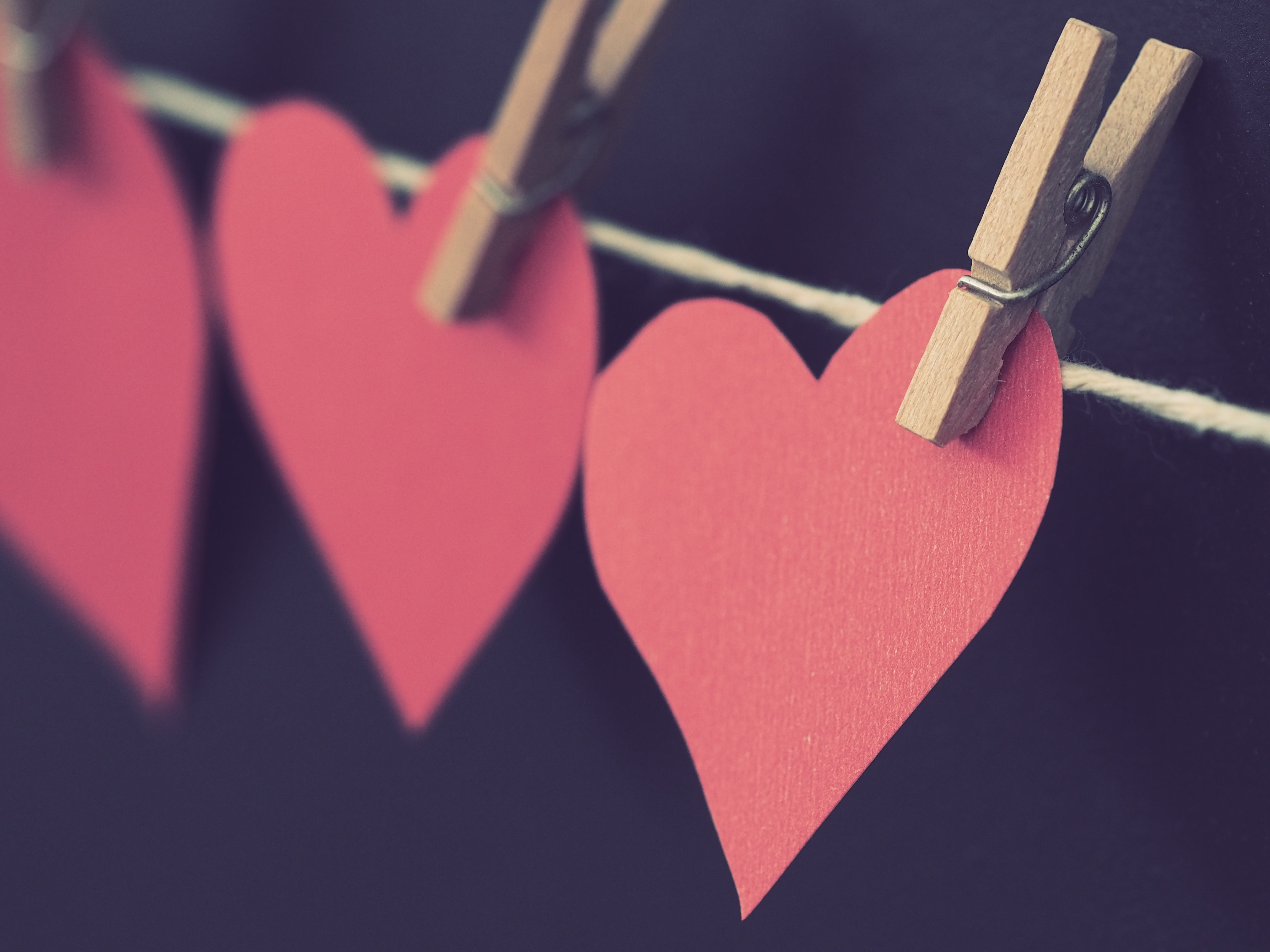 red heart shaped paper hanging on rope