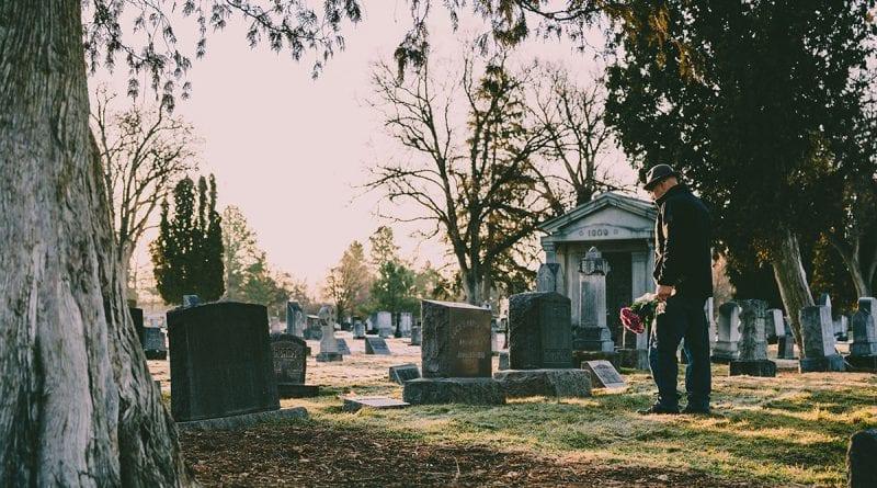 (credit brett sayles) man at funeral site