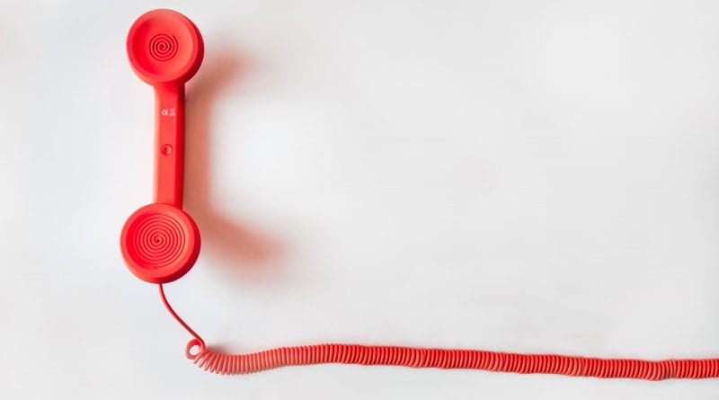 (credit negative space) red corded phone