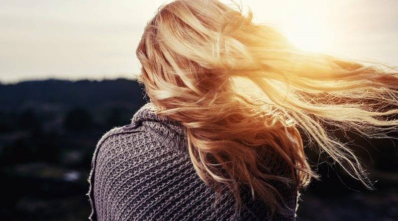 woman looking into golden sun