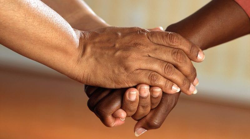 Credit Pixabay holding hands care