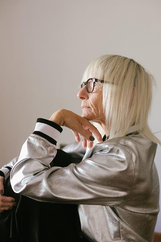 (credit Retha Ferguson) woman thinking metallic jacket